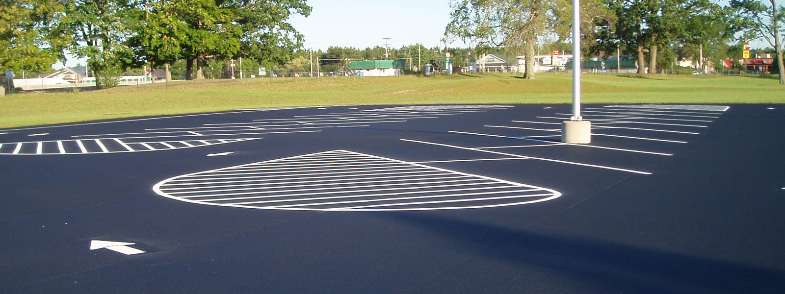 parking lot asphalt sealing and striping services in mason and manistee counties and surrounding areas.