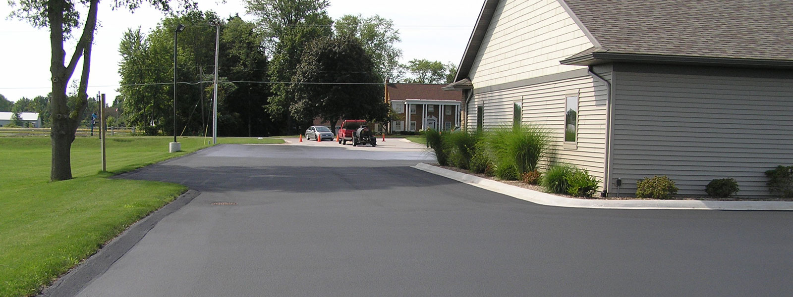 Asphalt sealcoating service for parking lots and driveways in Mansitee County and surrounding counties.