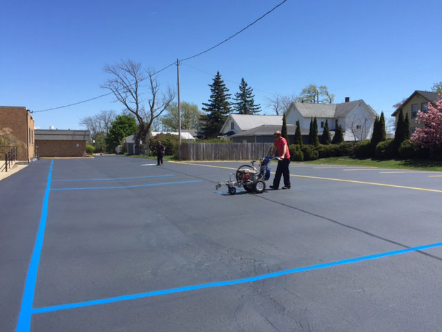 parking lot striping handicapped spaces blacktop ludington michigan