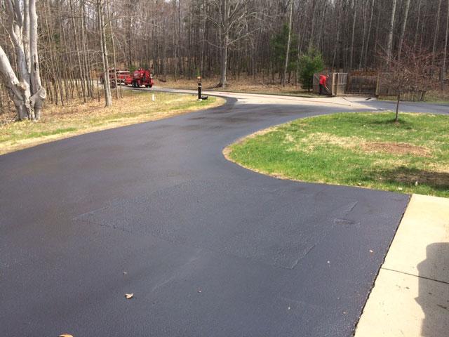 asphalt sealcoating end of driveway residential sealcoating ludington pentwater hart michigan mason county
